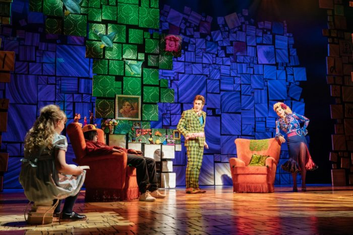 Matilda with Mr and Mrs Wormwood at home in Matilda the Musical at Bristol Hippodrome